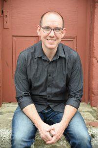 daniel bradshaw - sitting in front of door